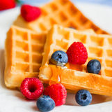 Belgian waffles with berries on rustic background Royalty Free Stock Images