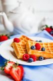 Belgian waffles with berries on rustic background Stock Images