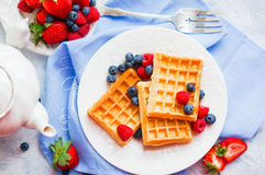 Belgian waffles with berries on rustic background Royalty Free Stock Image