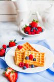 Belgian waffles with berries on rustic background Royalty Free Stock Photography