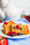 Belgian waffles with berries on rustic background Stock Photography