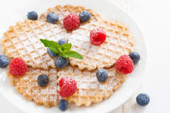 Belgian waffles with berries on white wooden table, close-up Stock Photography