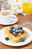 Belgian waffles with blueberries, coffee and orange juice Stock Photo