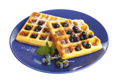 Belgian waffles with blueberries on plate isolated Stock Photos