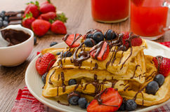Belgian waffles with blueberries, strawberries Stock Images