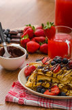 Belgian waffles with blueberries, strawberries Royalty Free Stock Images