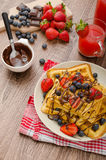 Belgian waffles with blueberries, strawberries Royalty Free Stock Photo