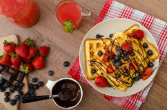 Belgian waffles with blueberries, strawberries Stock Image