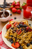 Belgian waffles with blueberries, strawberries Royalty Free Stock Photography