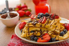 Belgian waffles with blueberries, strawberries Stock Photos