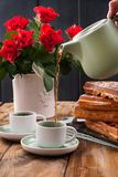 Belgian waffles for breakfast for two. Homemade pastries and a bouquet of red roses on the table. Delicious romantic lunch. Photo. Belgian waffles for breakfast royalty free stock photo