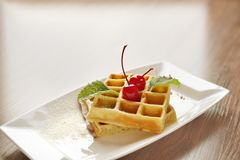 Belgian waffles with cherry Royalty Free Stock Photo