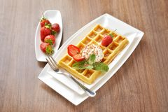 Belgian waffles with cherry Royalty Free Stock Photos
