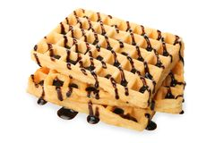 Belgian waffles with chocolate. Topping isolated on white Royalty Free Stock Images