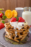 Belgian waffles with chocolate chips and fruits Stock Photography