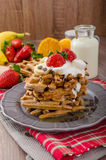 Belgian waffles with chocolate chips and fruits Royalty Free Stock Images