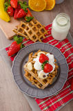 Belgian waffles with chocolate chips and fruits Stock Image