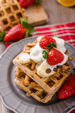 Belgian waffles with chocolate chips and fruits Stock Photos