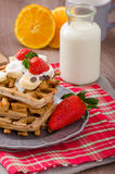 Belgian waffles with chocolate chips and fruits Royalty Free Stock Photos