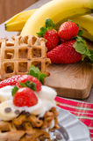 Belgian waffles with chocolate chips and fruits Stock Images