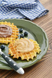 Belgian waffles with chocolate cream and peanut butter Royalty Free Stock Photo