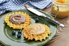 Belgian waffles with chocolate cream and peanut butter Stock Photography