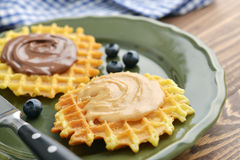 Belgian waffles with chocolate cream and peanut butter Stock Image
