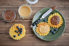 Belgian waffles with chocolate cream and peanut butter Royalty Free Stock Images