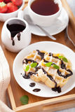Belgian waffles with chocolate and powder sugar for breakfast Stock Images