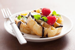 Belgian waffles with chocolate and raspberry for breakfast Stock Image