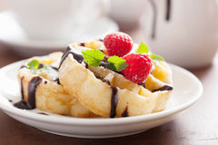 Belgian waffles with chocolate and raspberry for breakfast. Belgian waffle with chocolate and raspberry for breakfast Royalty Free Stock Images