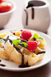 Belgian waffles with chocolate and raspberry for breakfast Stock Photo