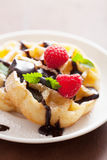 Belgian waffles with chocolate and raspberry for breakfast Stock Images
