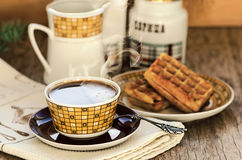 Belgian waffles with coffee on the vintage wooden table Stock Photos