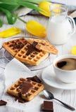 Belgian waffles dark chokolates and coffee. Sweet breakfast Belgian waffles and coffee Stock Photo