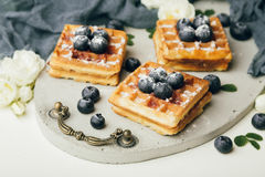 Belgian waffles with fresh berries and mint Royalty Free Stock Photos