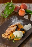 Belgian waffles with fresh peaches Royalty Free Stock Image