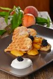 Belgian waffles with fresh peaches Royalty Free Stock Images