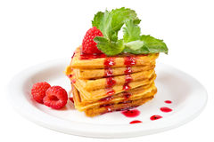 Belgian waffles with fresh raspberries. Plate of belgian waffles with fresh raspberries, mint and jam Stock Images