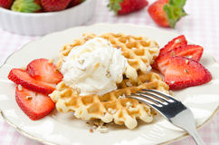 Belgian waffles with fresh strawberries and whipped cream Royalty Free Stock Image