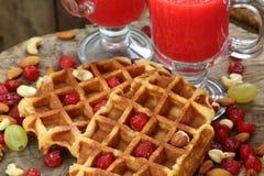 Belgian waffles with fruit juice Stock Photos