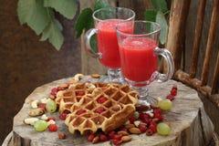 Belgian waffles with fruit juice Royalty Free Stock Photos