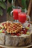 Belgian waffles with fruit juice Stock Photo