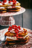 Belgian waffles with fruit and syrup, homemade. Served on printed dish with a spoon Royalty Free Stock Photography