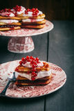 Belgian waffles with fruit and syrup, homemade. Served on printed dish with a spoon Stock Images