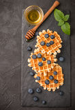Belgian  waffles with honey and fresh berries blueberry and mint Royalty Free Stock Photos