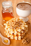 Belgian waffles with honey, nuts and a cup of espr Royalty Free Stock Photos