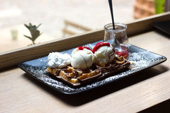 Belgian waffles with ice cream , chocolate, Royalty Free Stock Images