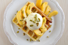 Belgian Waffles. With ice cream, peach and pistachio Royalty Free Stock Photo