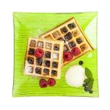 Belgian waffles with ice cream, raspberries and blueberries Stock Photo